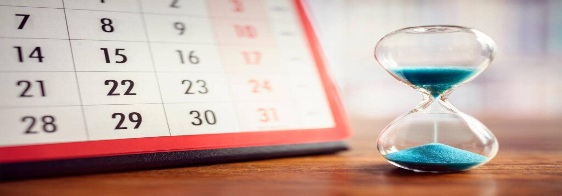a calendar and an hour glass